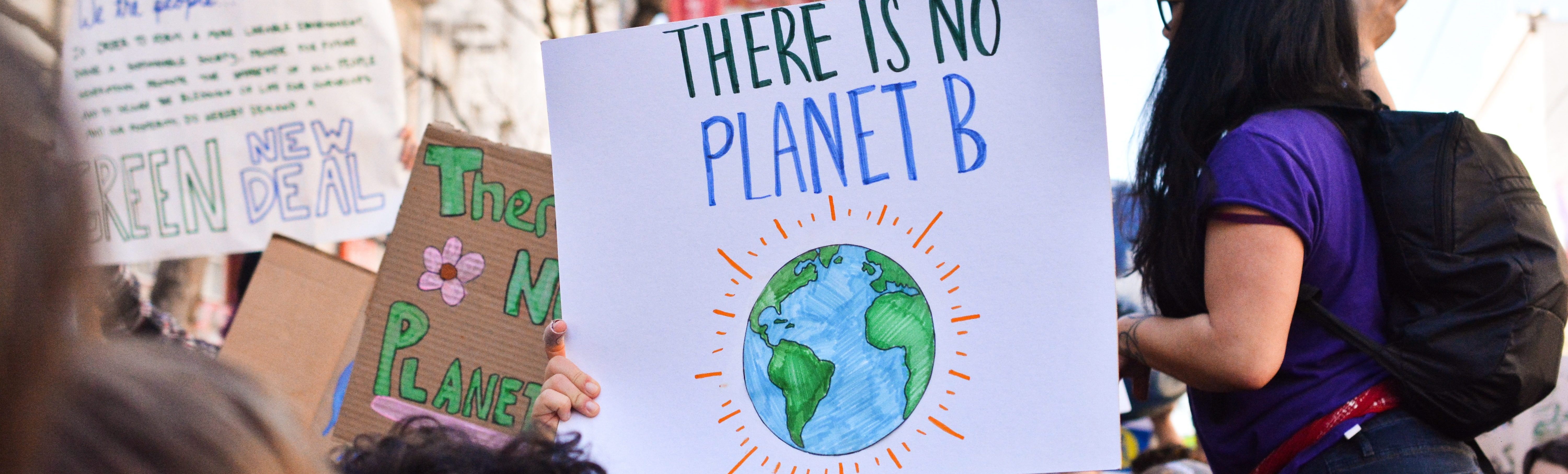 a protest where you can read a sign saying, there is no planet B