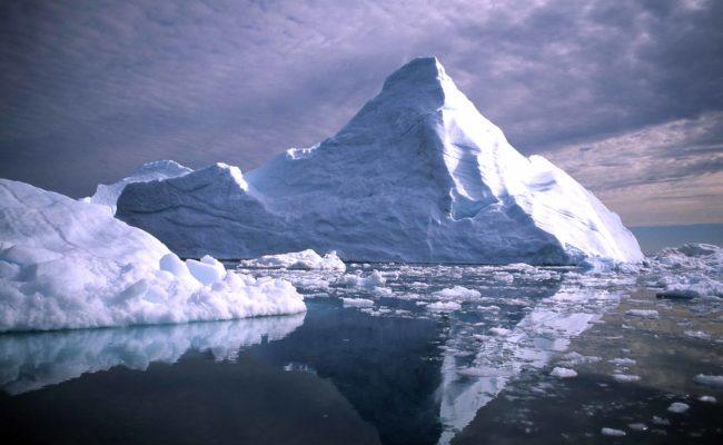 iceberg melting in the ocean.